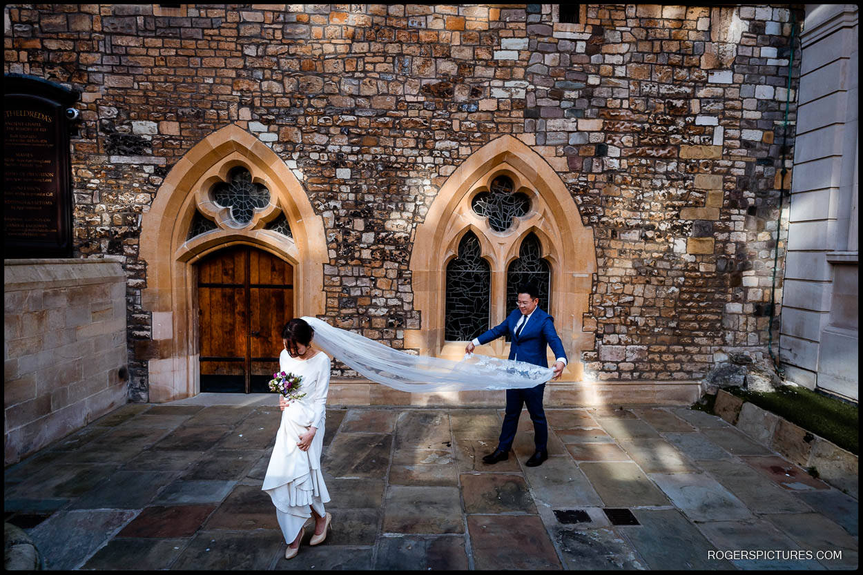 Newly married couple outside St Etheldreda's church London