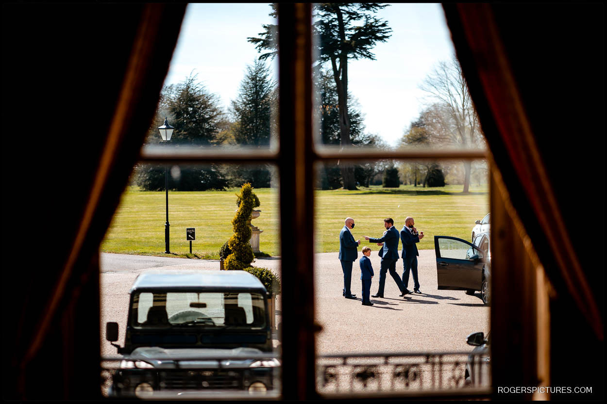 Groomsmen outside at Luton Hoo before a wedding ceremony