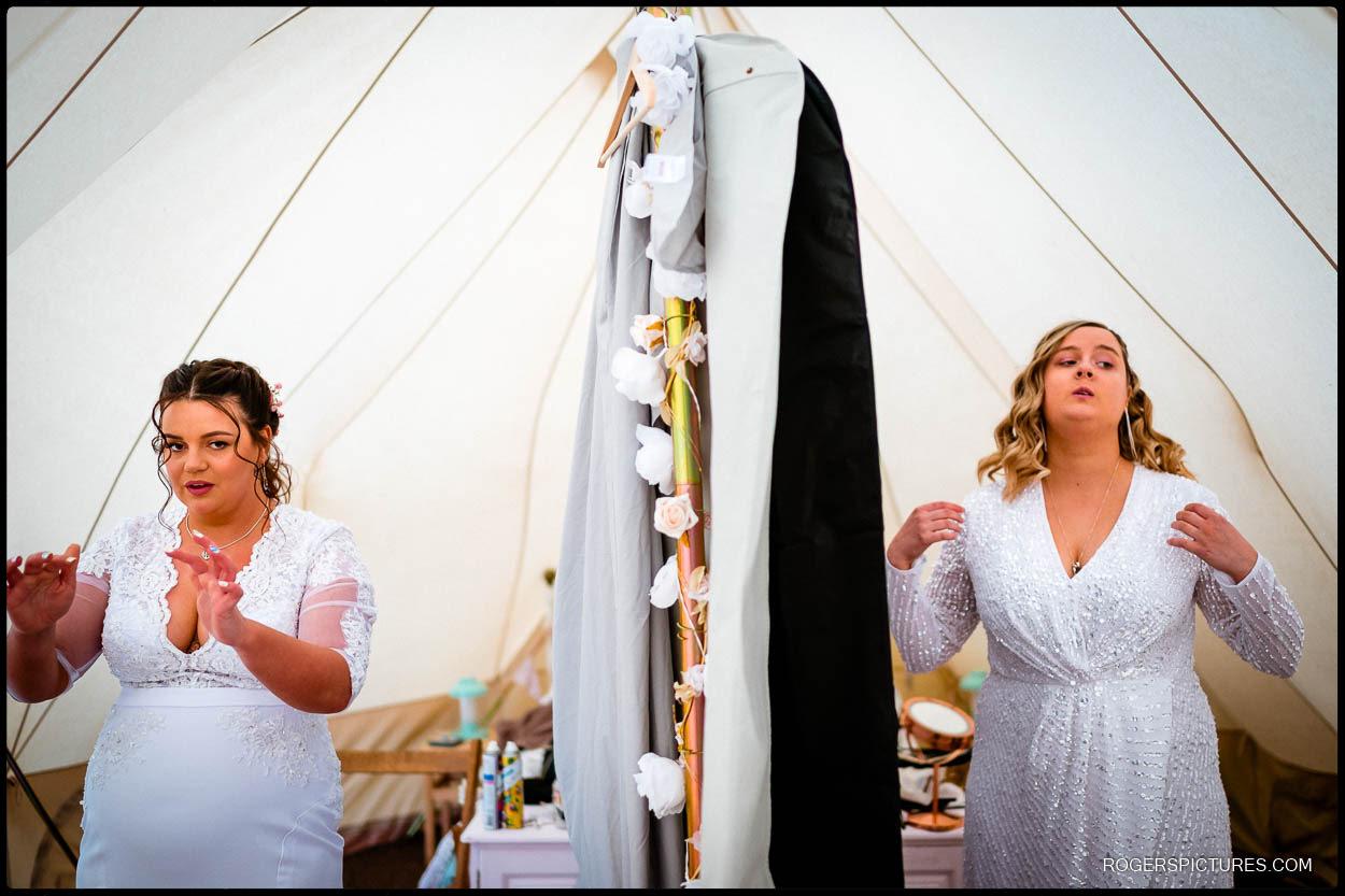 Two brides at a glamping wedding