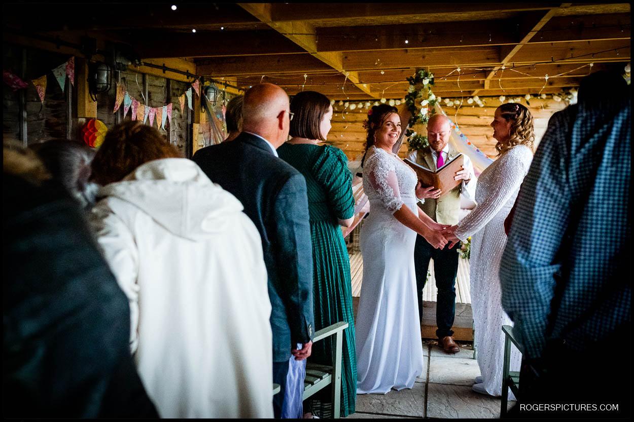 Same sex wedding at glamping wedding venue in Kent