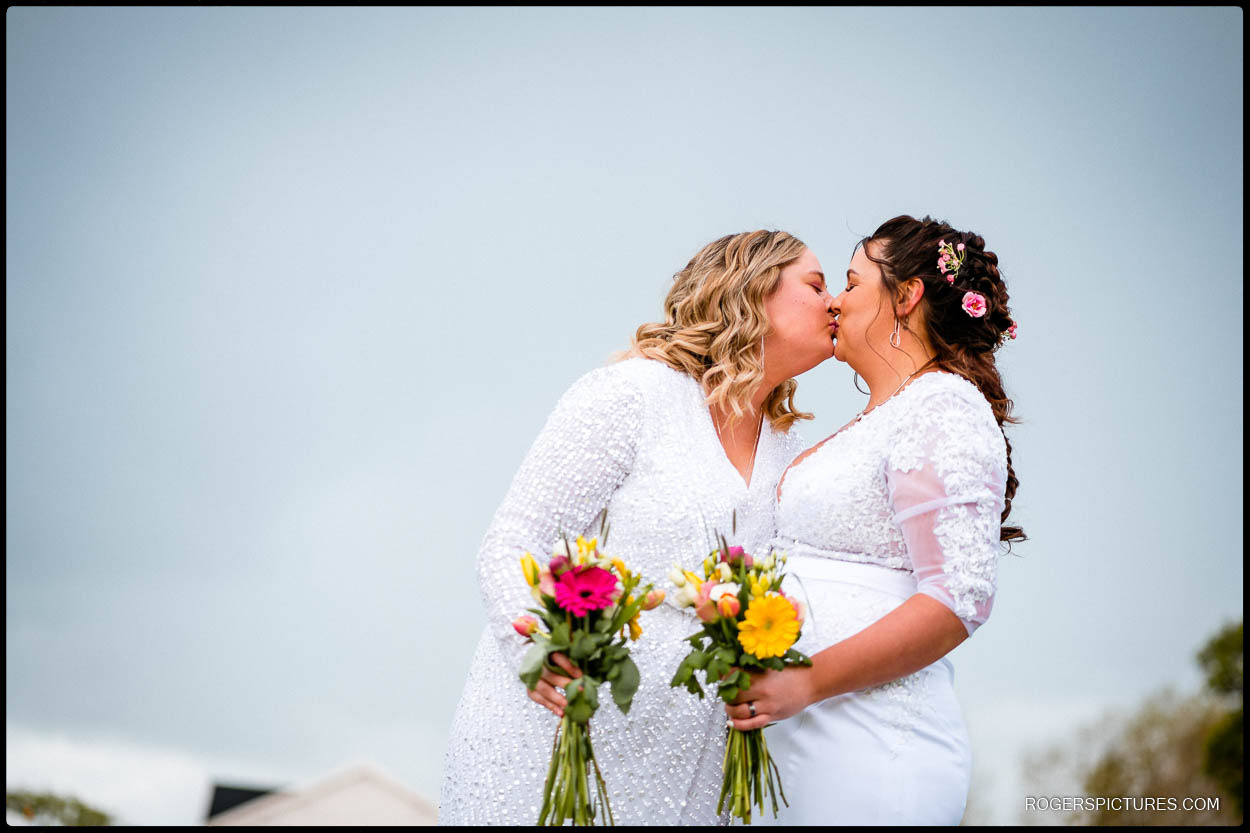 Two brides kiss after getting married