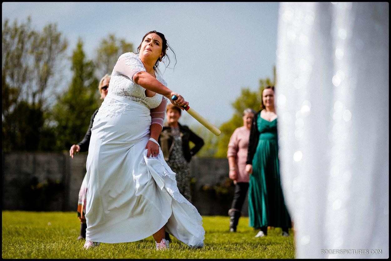 Bride plays rounders at a wedding
