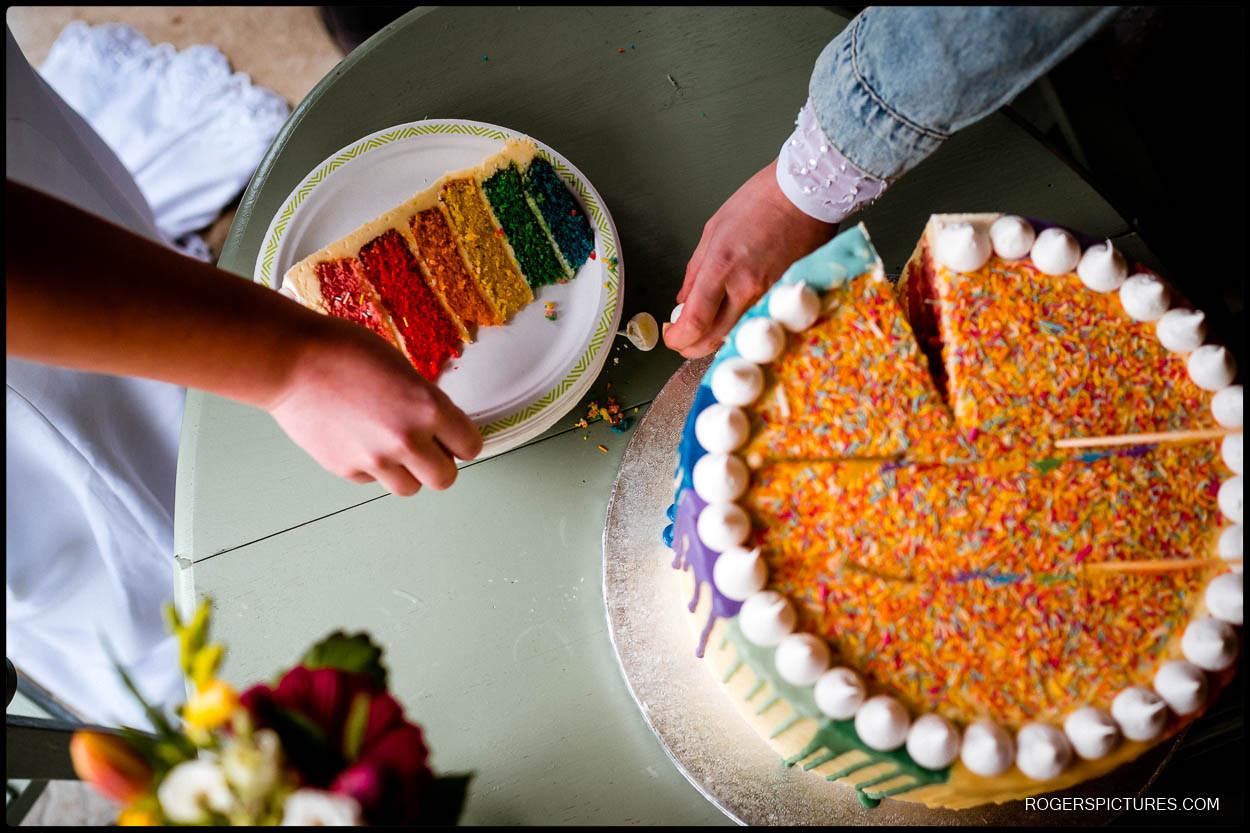 Rainbow wedding cake at a same sex wedding in Kent