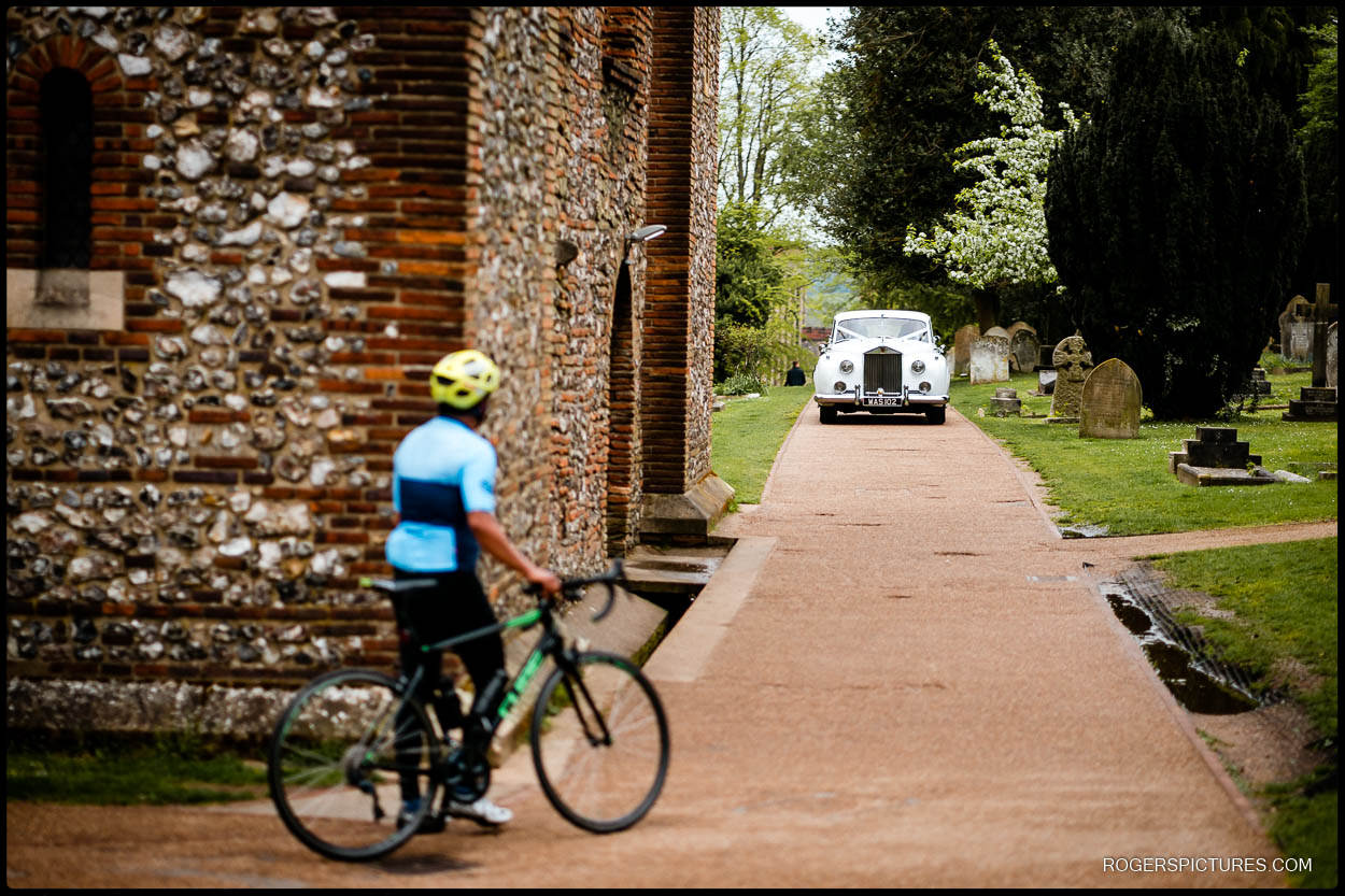 Bride arrives in wedding car at St Albans Cathedral wedding