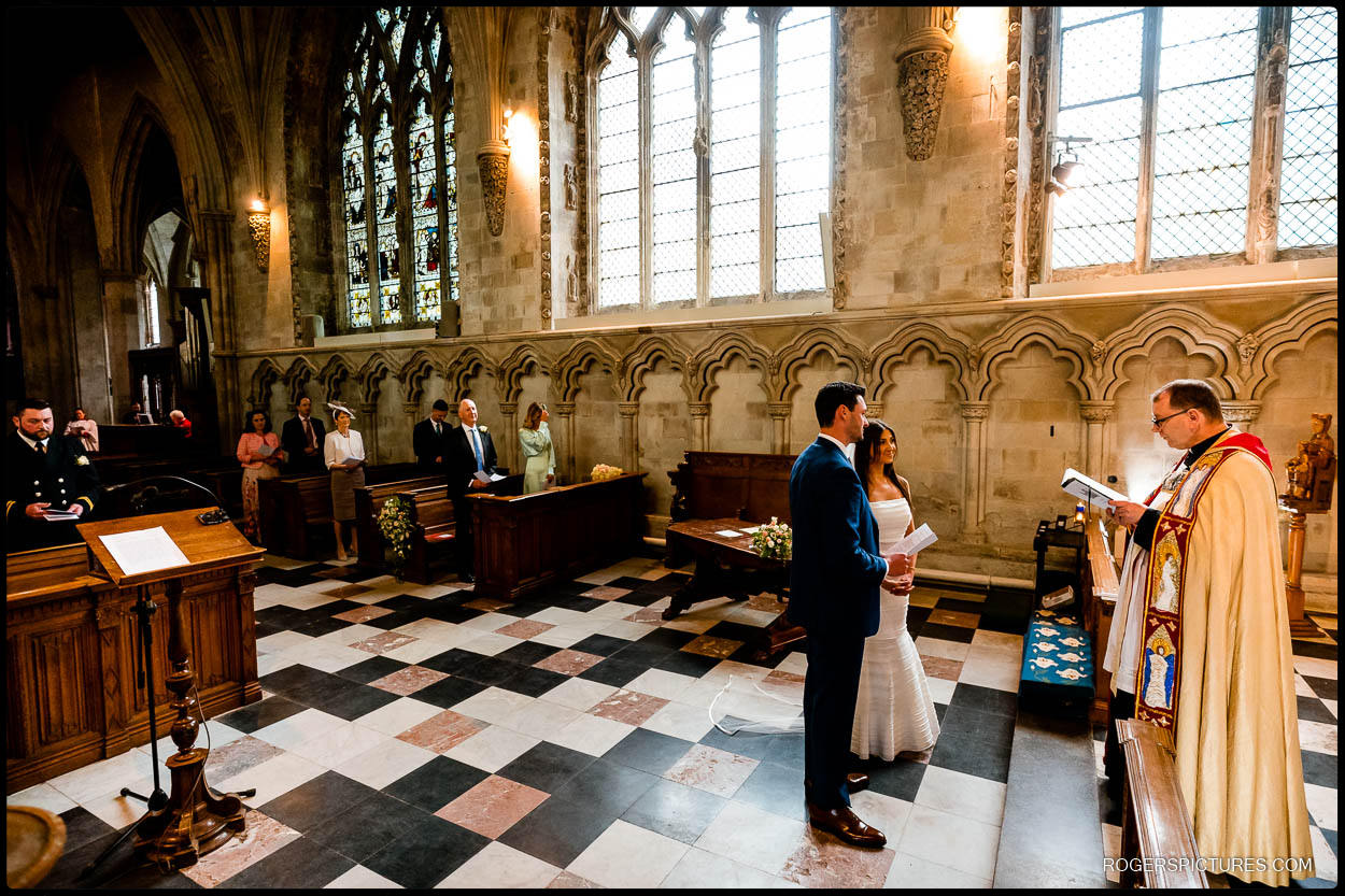 Bride and groom during small wedding at St Albans Cathedral in Herts
