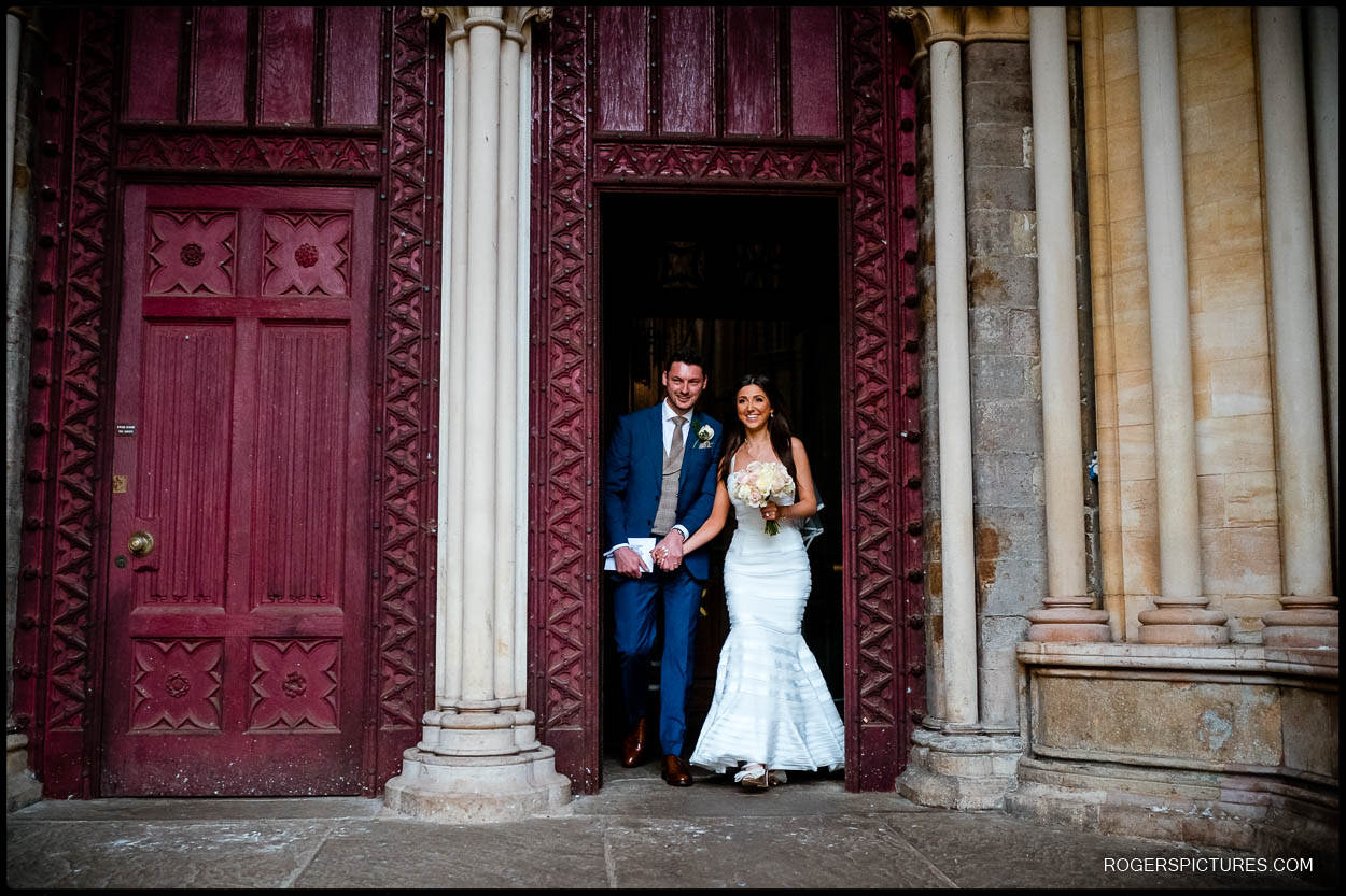 Bride and Groom leaving St Albans Cathedral wedding