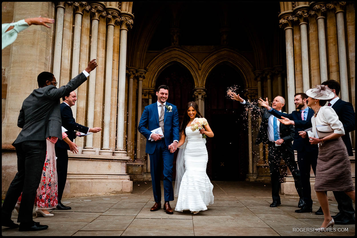 Newly married couple outside St Albans Cathedral