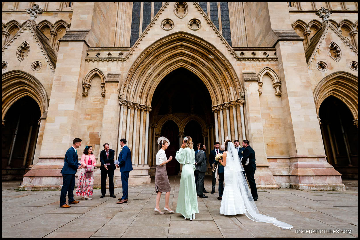 Wedding party outside St Albans Cathedral