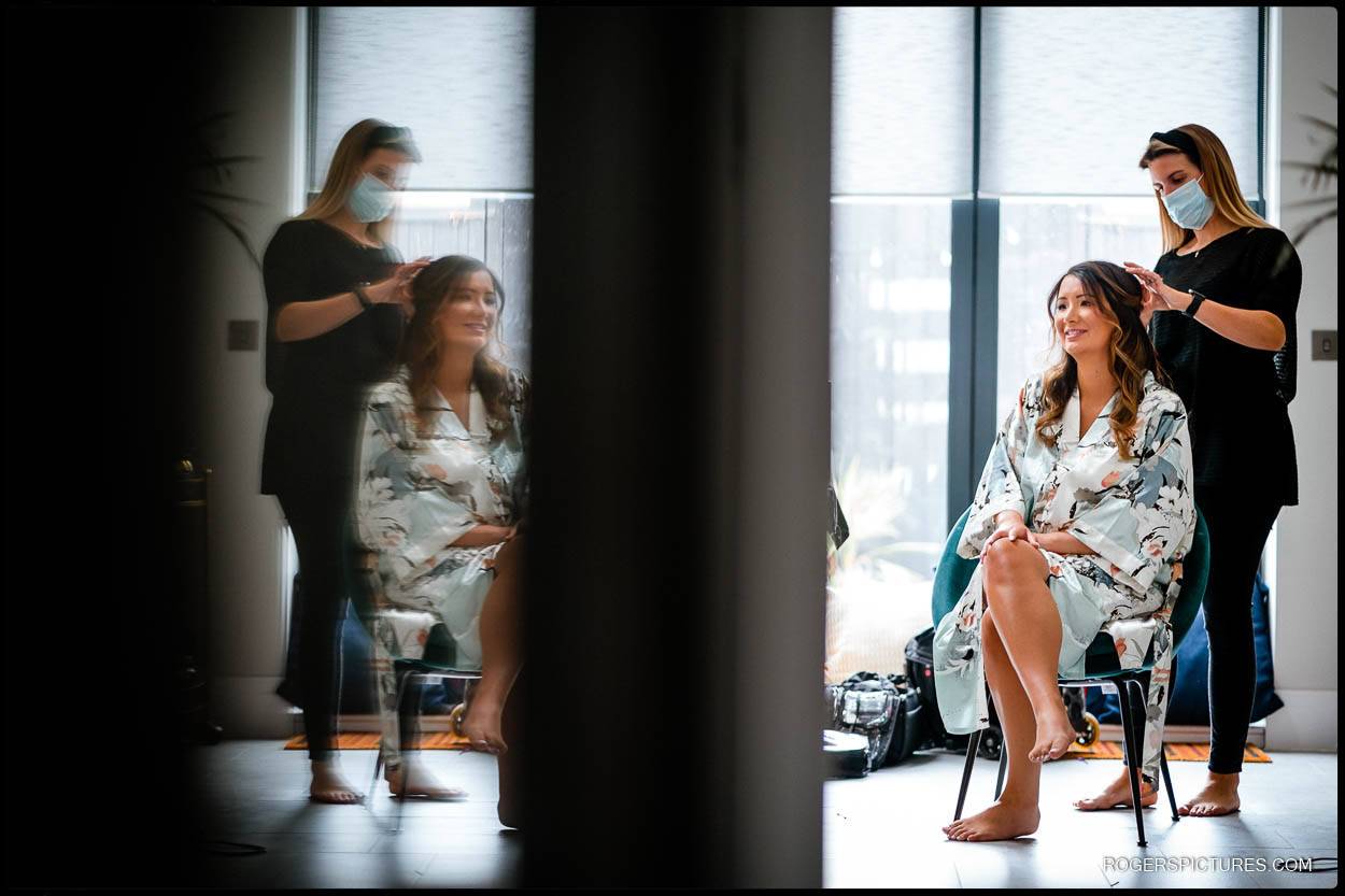 Bride having hair and makeup reflection