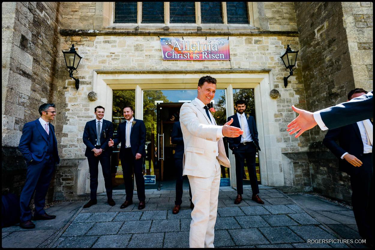 Groom greets guests at Hemel Hempstead Church wedding