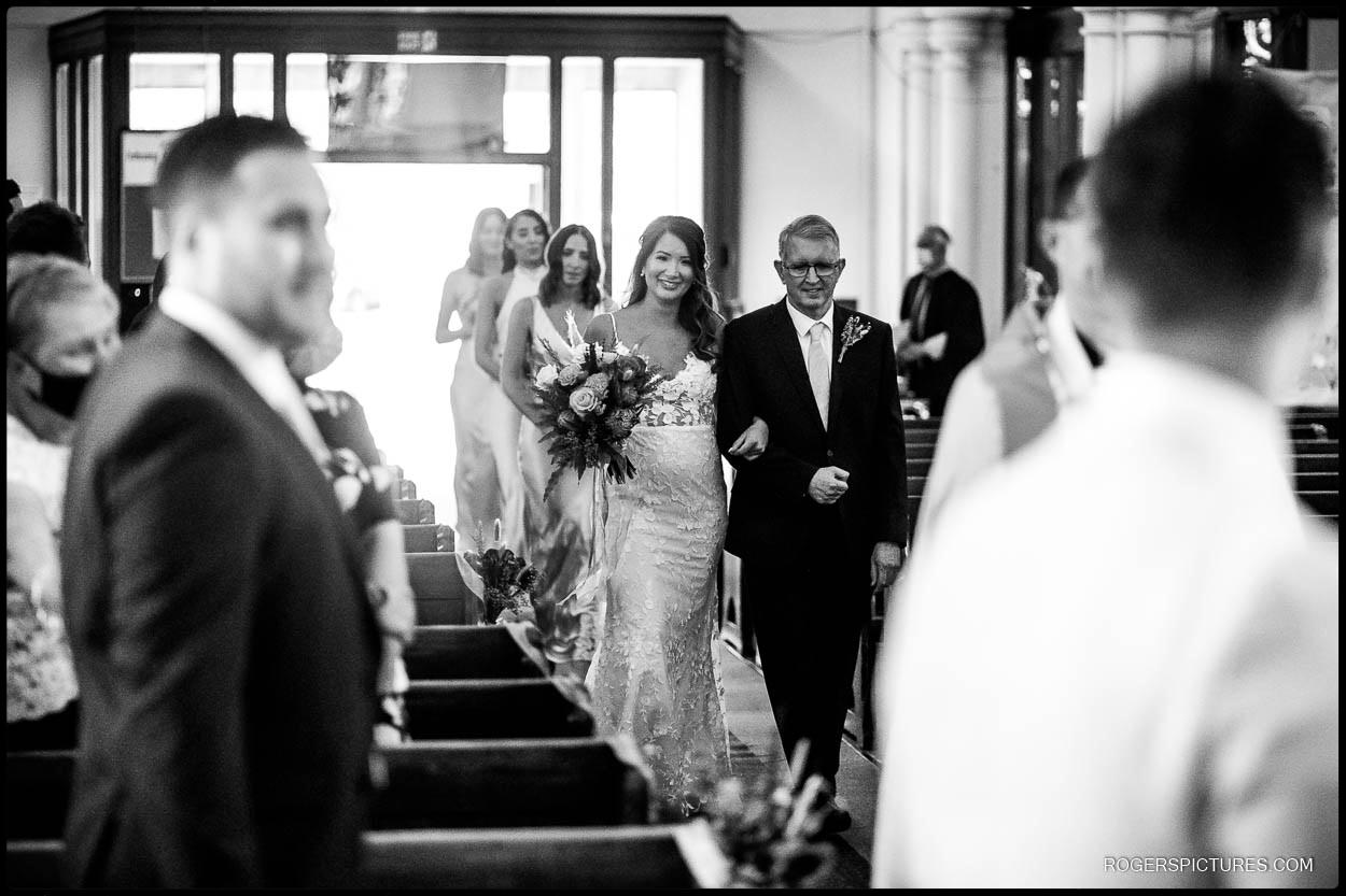 Bride and Dad walk down the aisle in Hertfordshire