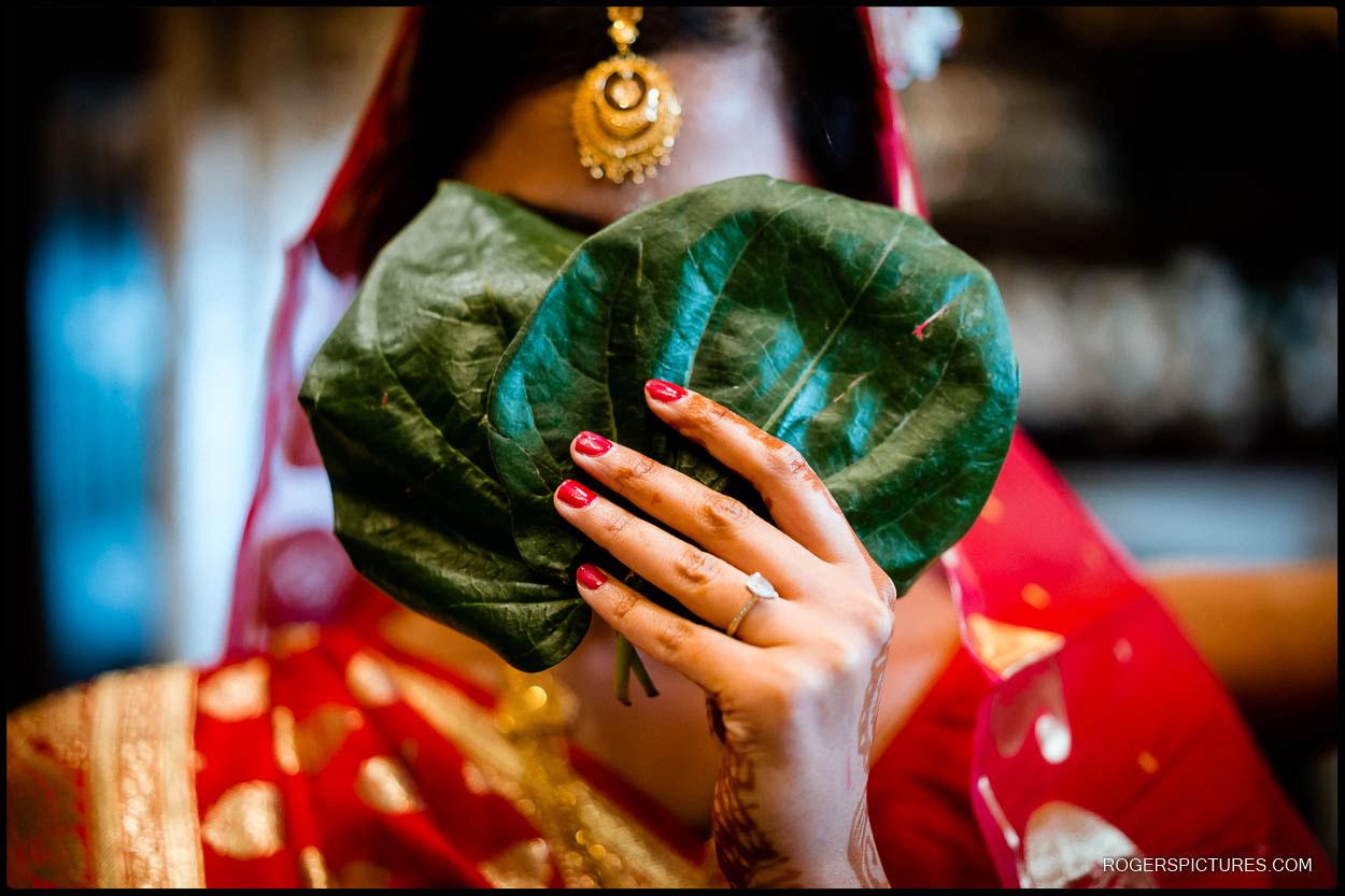 Bride arrives at Froyle Park Asian wedding ceremony