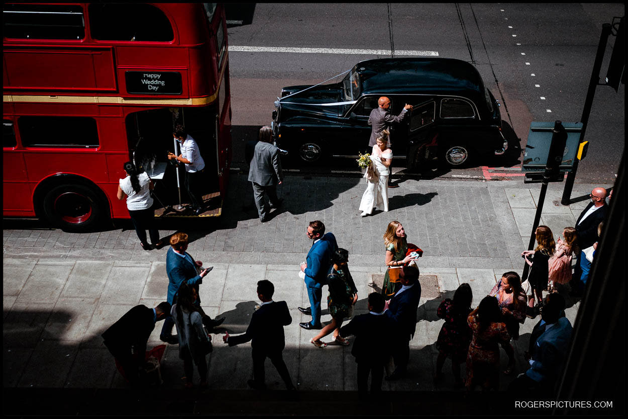 Bride arriving in a taxi Old Marylebone Town Hall for a wedding