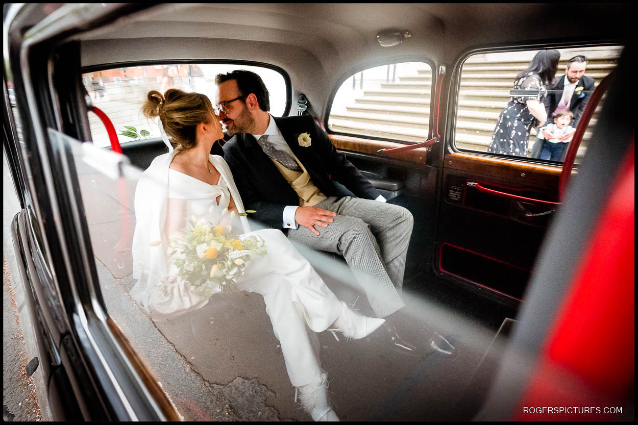 Wedding couple in a London taxi