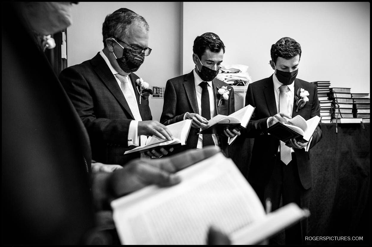Groomsmen during the Tish at Hampstead Garden Suburb Synagogue