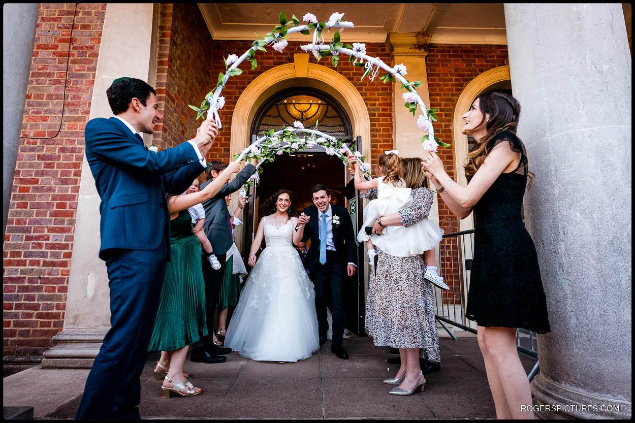 Bride and groom leave Hampstead Garden Suburb Synagogue
