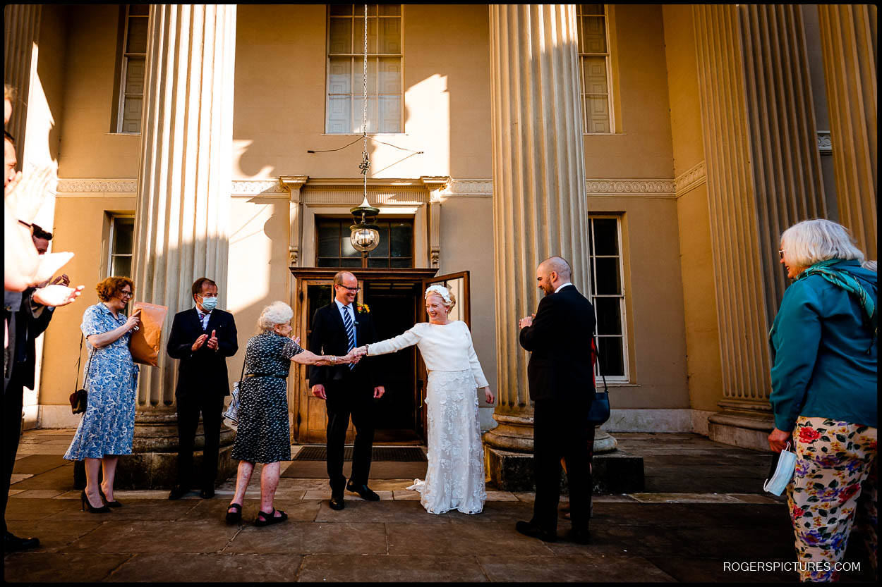 Wedding guests in the courtyard at Kenwood House