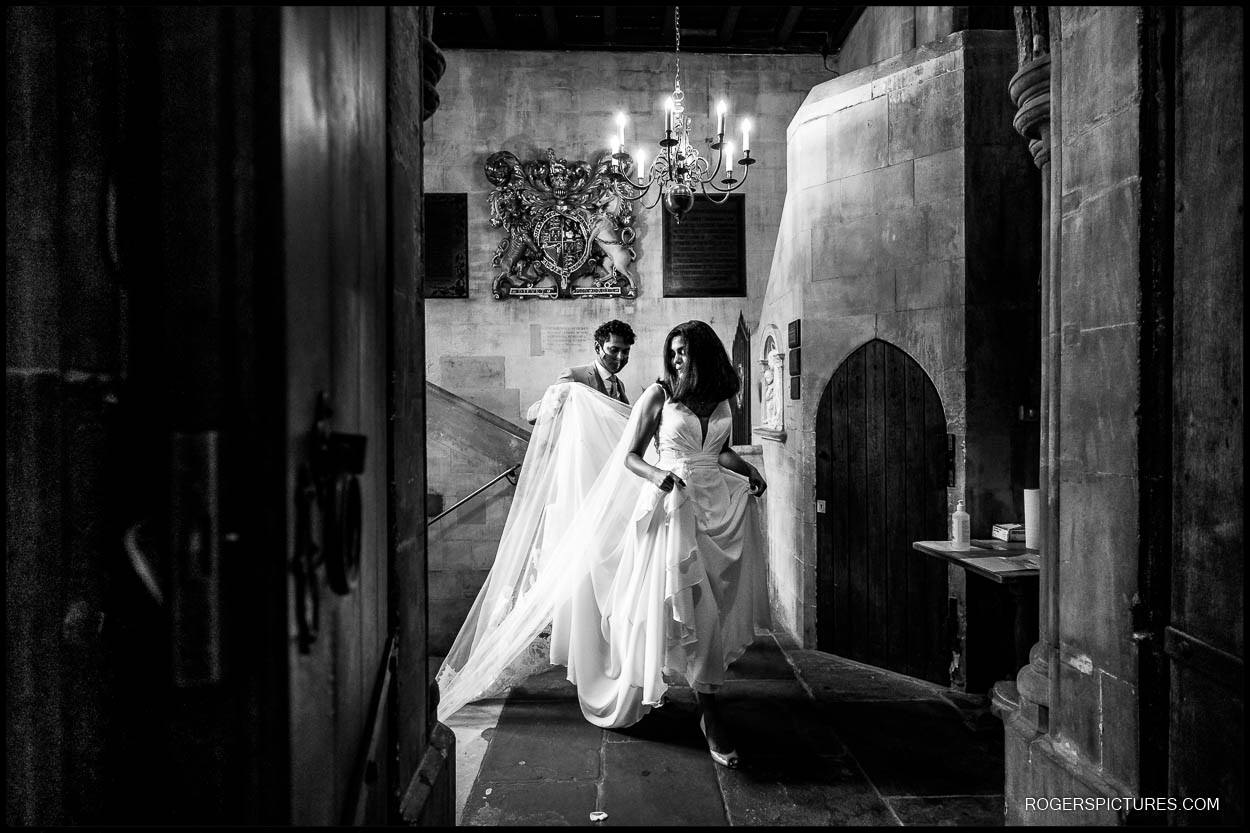 Black and white photo of bride arriving at St Etheldreda's Church