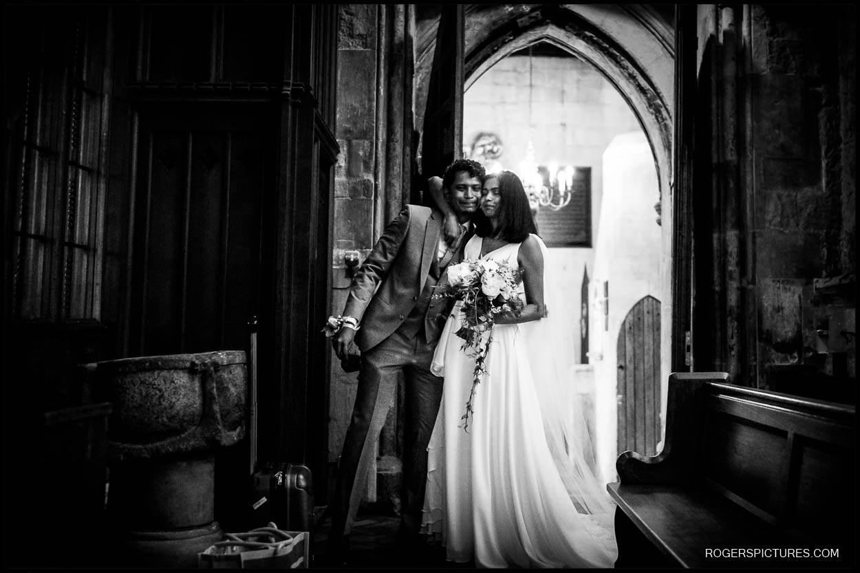 Brother and sister at St Etheldreda's Church wedding