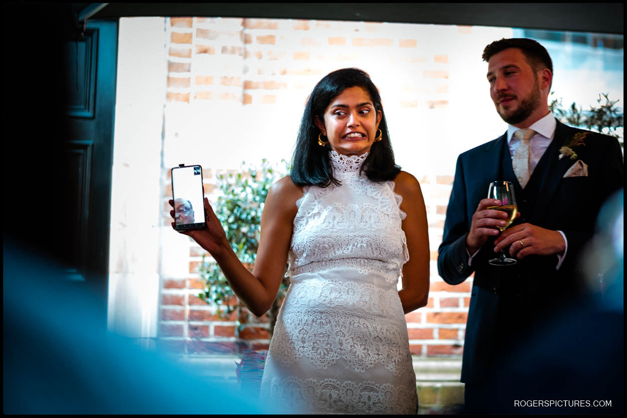 Bride and groom on zoom call with parents in another country
