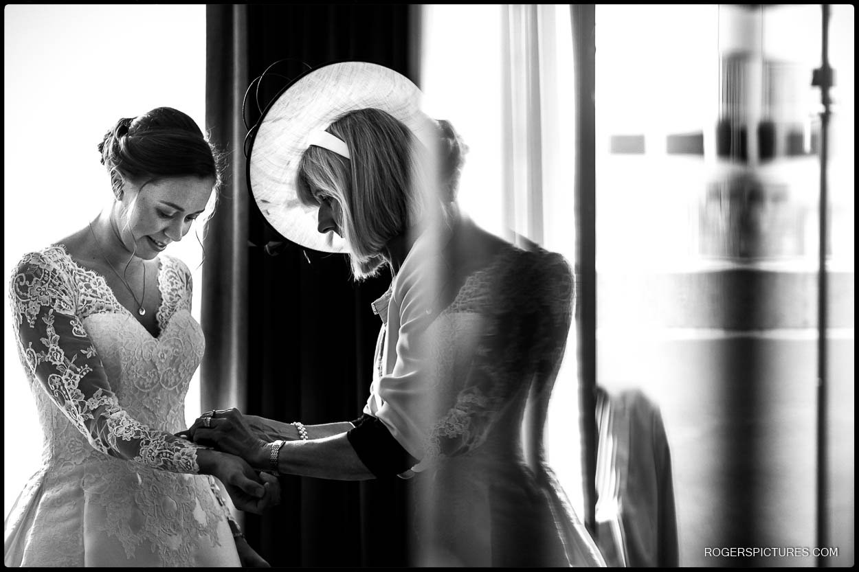 Mother of the bride helps daughter get ready in London